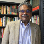 R. Radhakrishnan stands smiling in his office