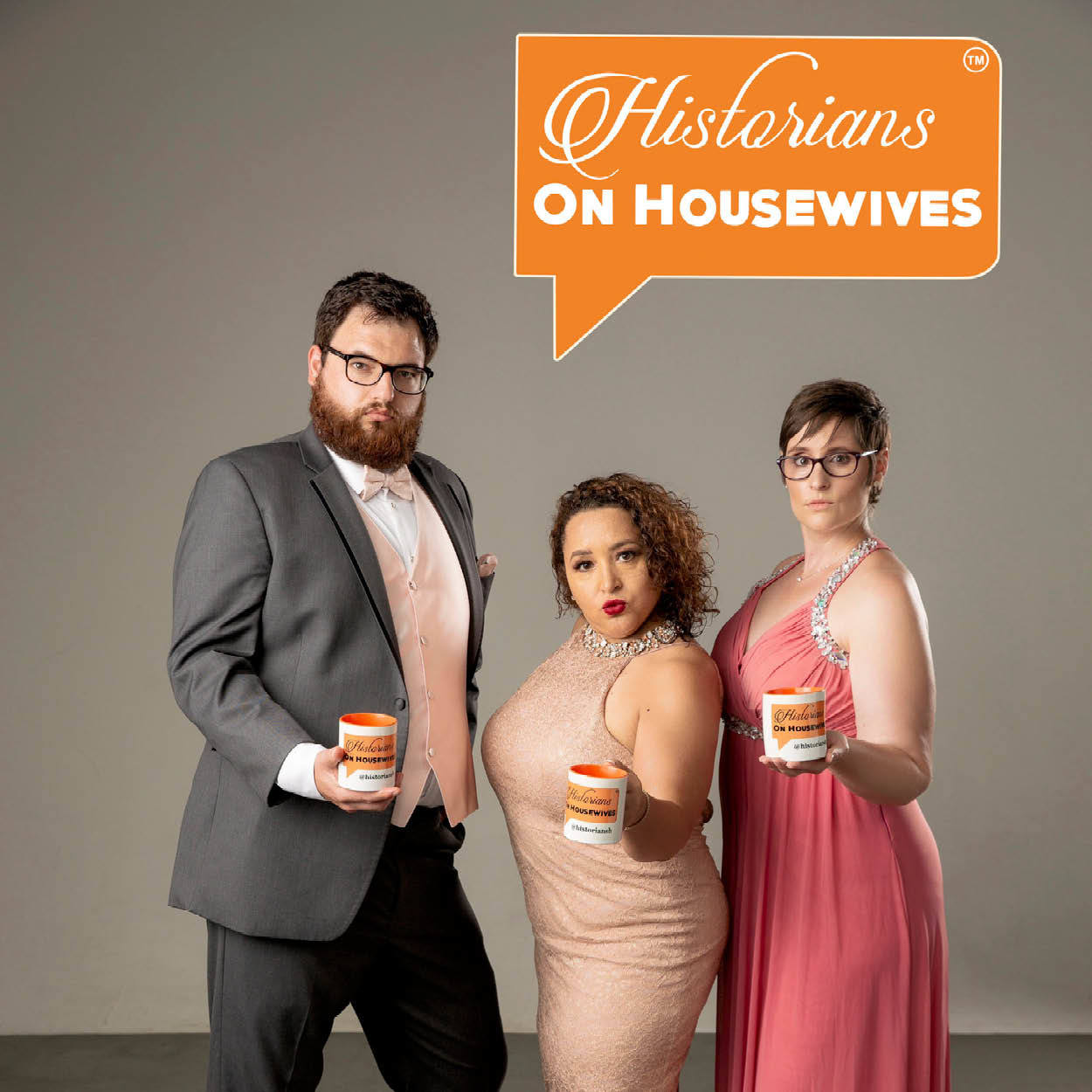 History on Housewives logo on top of a photo of the hosts all wearing formal wear